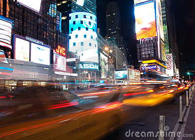 Times square cabs passing by Editorial Stock Photo