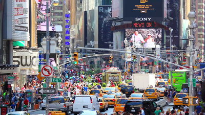 Times Square. New York, New York, USA - July 11, 2012: Busy traffic and crowds of people in Times Square, Manhattan