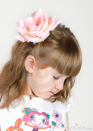 Timid girl with a flower in hair