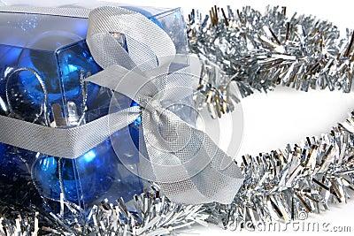 Tinsel and box with christmas balls
