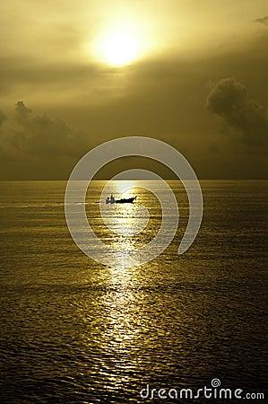 Tiny Boat in the Ocean