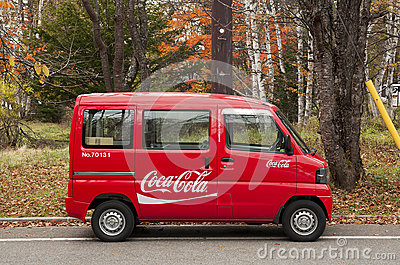 Tiny Coca cola minibus delivers goods to remote locations in Japanese mountains. Editorial Photo