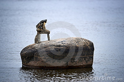 Tiny Inuksuk Atop Boulder in River