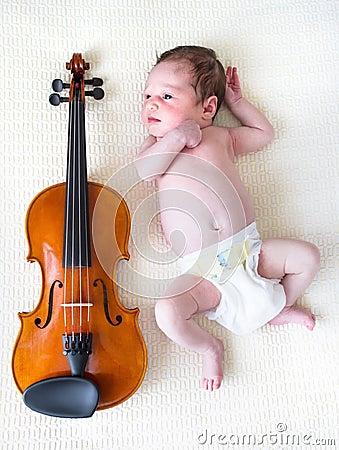 Free Tiny Newborn Girl Lying Next To A Violin Stock Photography - 27650392