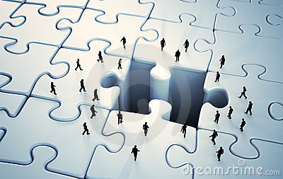 Tiny people jigsaw puzzle Stock Photo