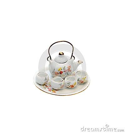 Tiny souvenir teapot with bowls