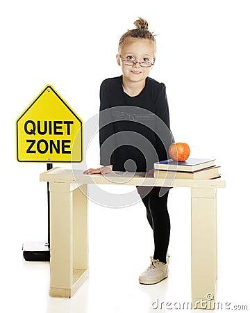 Tiny Teacher Behind Her Desk