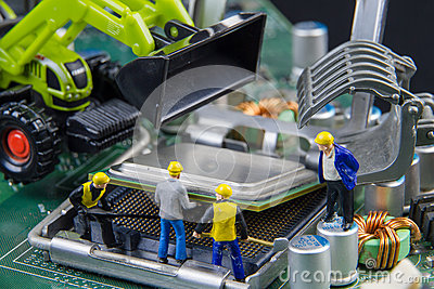 Tiny toys team of engineers repairing circuit mother board compu Stock Photo