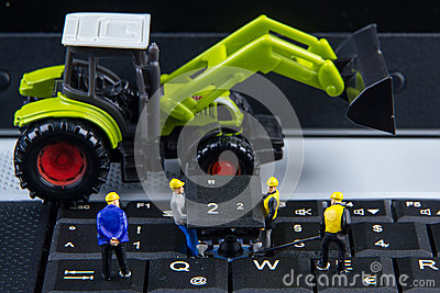 Tiny toys team of engineers repairing keyboard computer laptop.Computer equipment.Computer repair concept Stock Photo