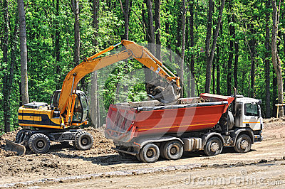 Tipper truck loaded by an excavator
