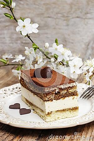 Tiramisu cake on white plate