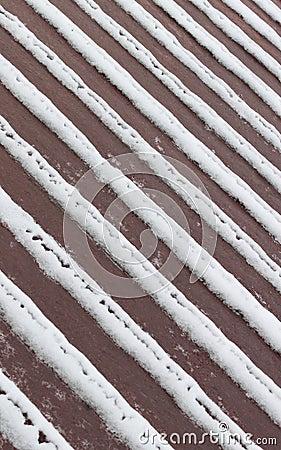 Tiras de la nieve en cubierta