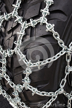 Tire with snow chains