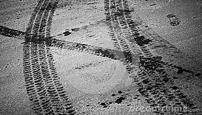 Tire tracks and footstep on the asphalt