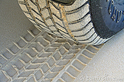 Tire Tread On Beach Sand