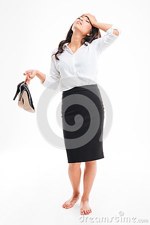 Free Tired Asian Businesswoman Standing Barefoot And Holding High Heels Shoes Royalty Free Stock Image - 77189726