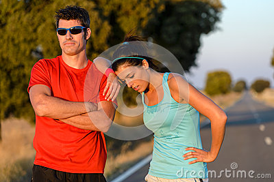 Tired athletes after running on country road