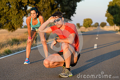 Tired athletes after running in road