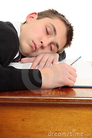 Free Tired Bored Student At Desk Stock Photography - 14958502