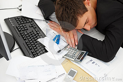 Tired business man sleeping on desk