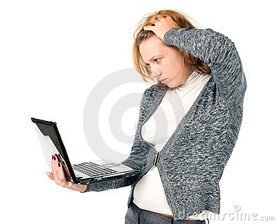 A tired business woman using laptop