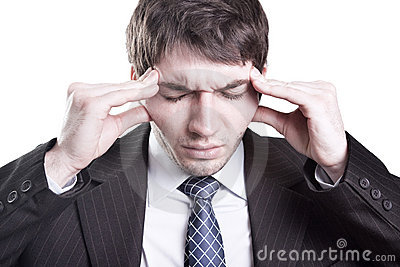 Tired businessman having a headache