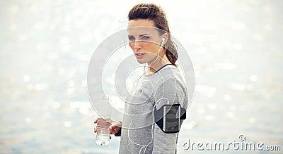 Tired Female Runner with Bottled Water