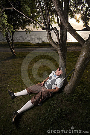 Tired golfer taking a nap.