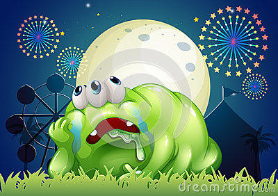 A tired green monster at the carnival