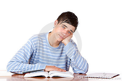 Tired handsome male student reading study books