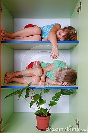Tired kids in a closet