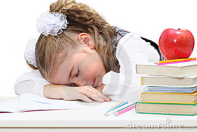 Tired little girl sleep at books