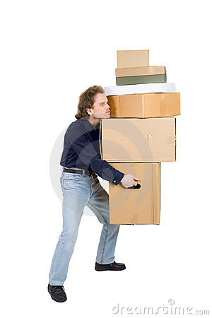 Tired man carrying many cardboard boxes