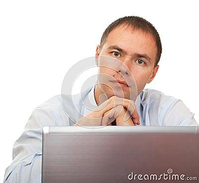 Tired man before laptop.