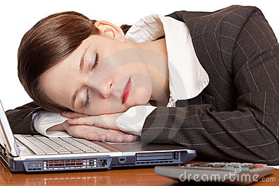 Tired overworked business woman sleeps in office