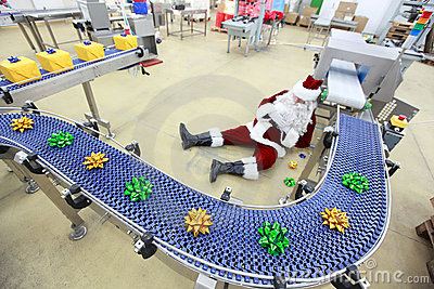 tired overworked santa claus in factory