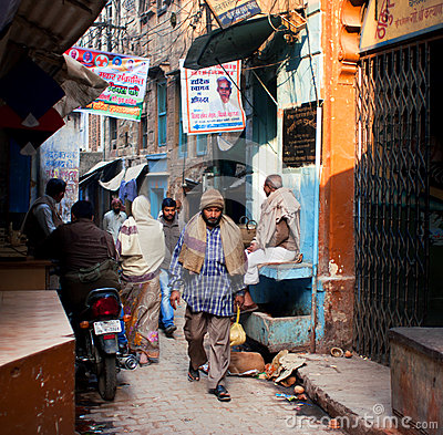 Tired people returning home after working through the narrow streets Editorial Photo