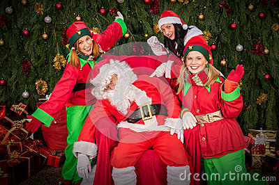 Tired Santa Clause with elf helper sleep chair