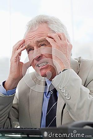 A tired senior manager having a headache