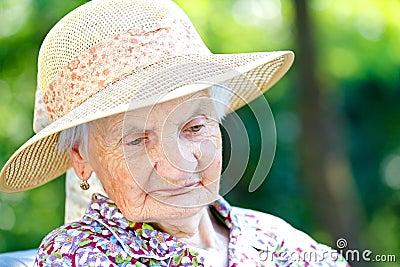Tired senior woman Stock Photo