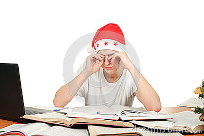 Tired student in santa s hat