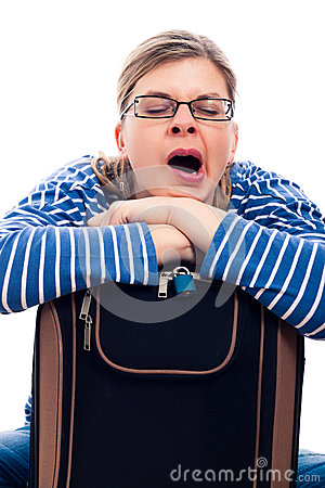 Tired traveller woman yawning