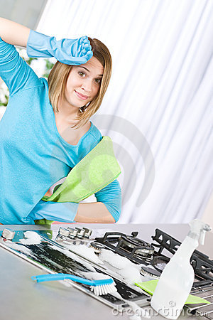 Free Tired Woman Cleaning Kitchen With Brush Royalty Free Stock Photos - 14247558
