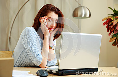 Tired woman with closing eyes sitting