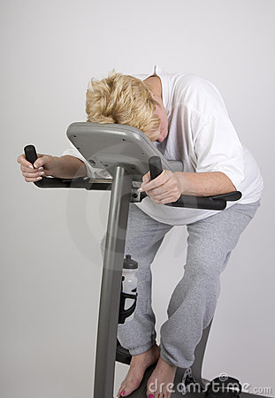 Tired woman on excercise bike