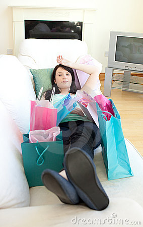 Tired woman relaxing after shopping