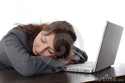 Tired woman sleeping with laptop