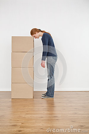 Tired Woman with a Stack of Boxes