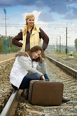 Tired women on rail station