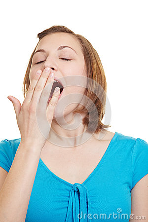 Tired yawning woman